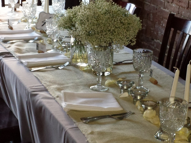 burlap table runner with babys breath centerpieces