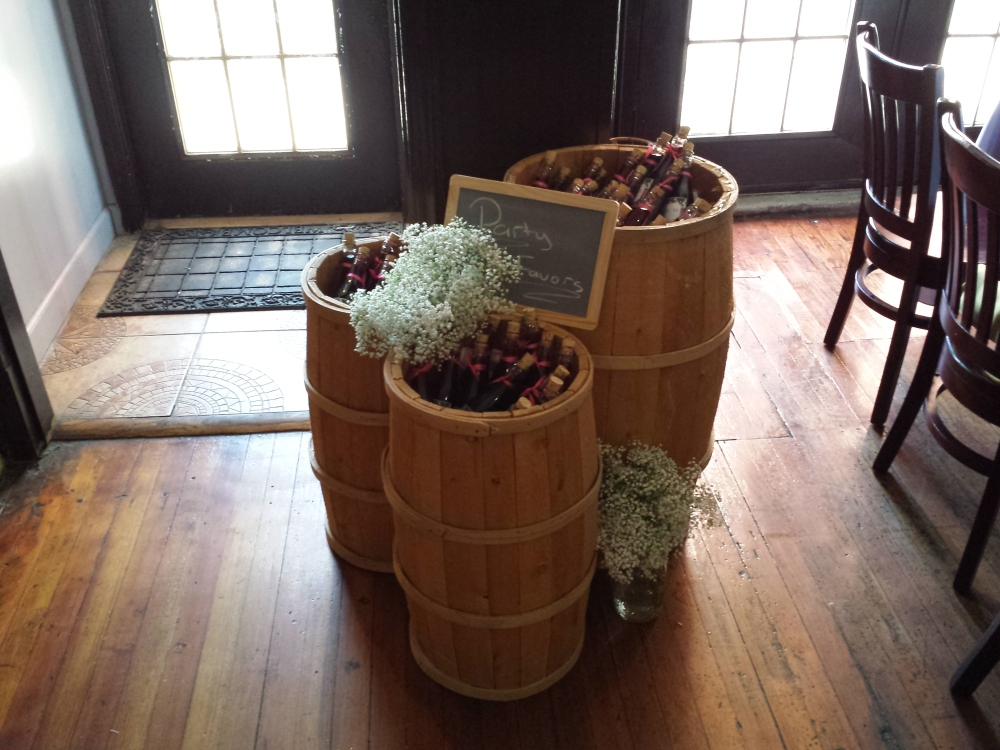 barn barrels holding the wine bottle party favors
