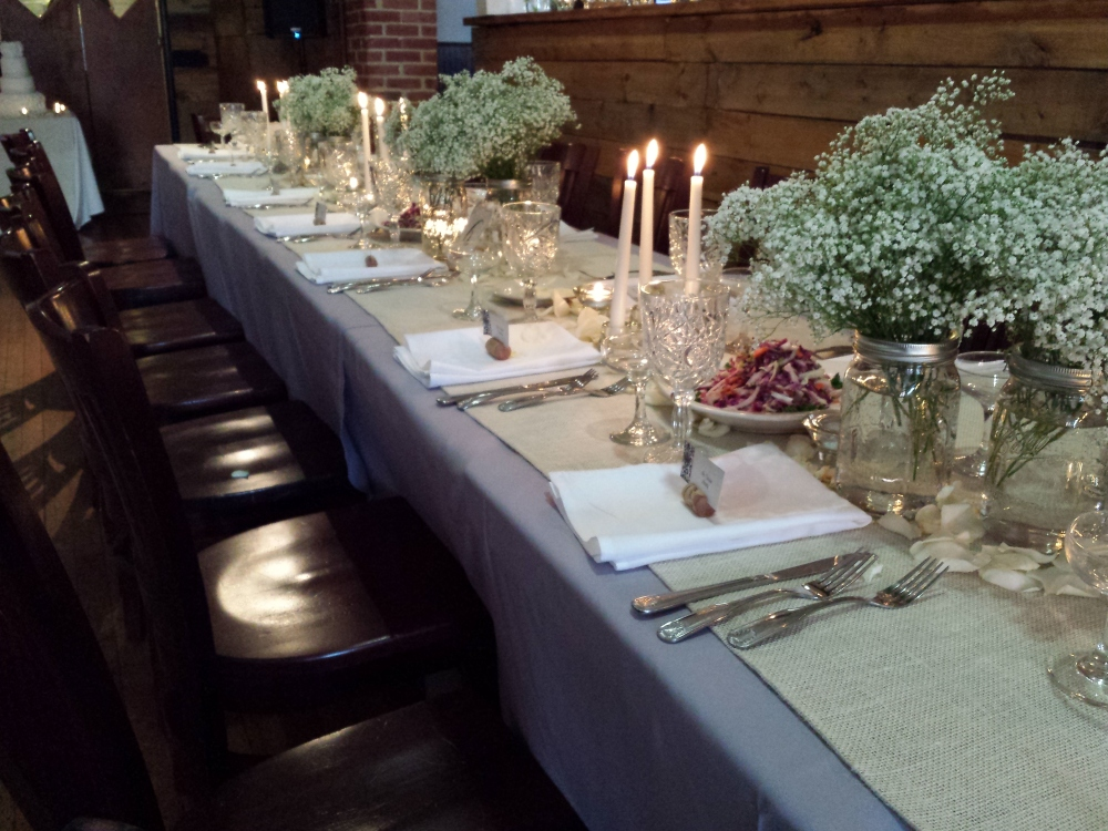 babys breath and candle centerpieces with rose petals