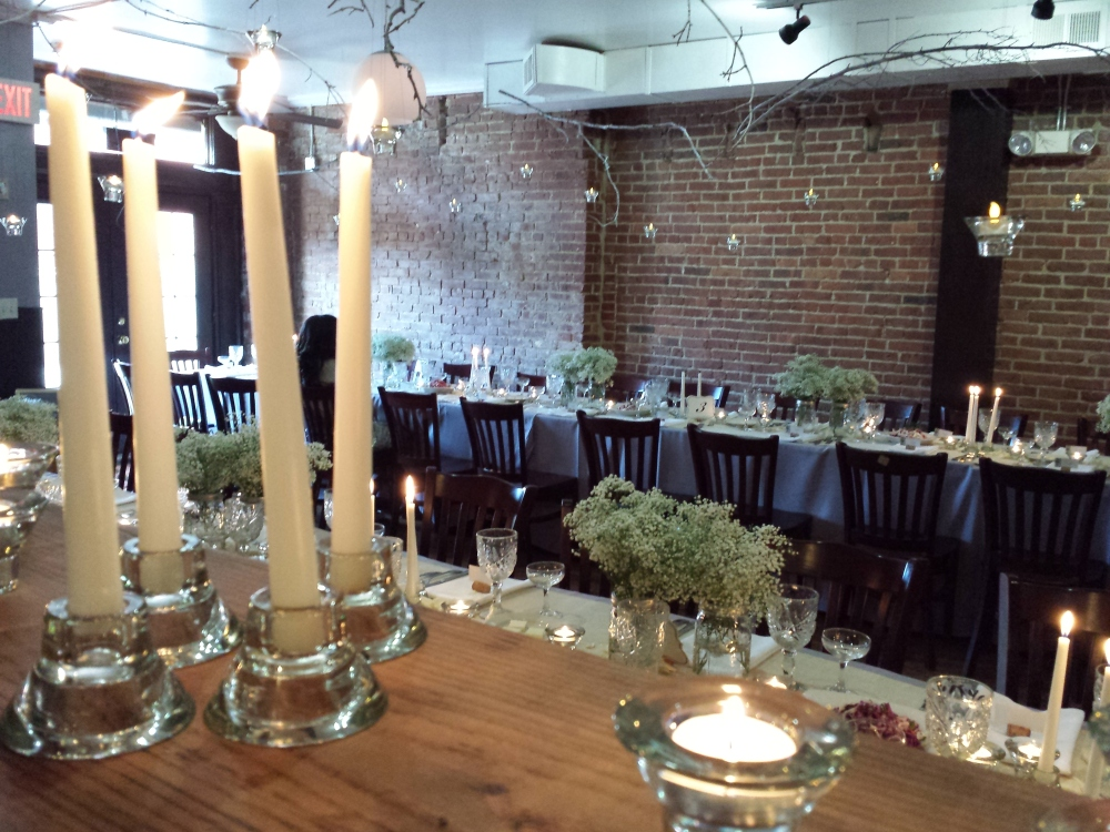 Modern rustic wedding decor with romantic candle lighting