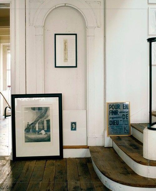 artwork on floor at bottom of staircase